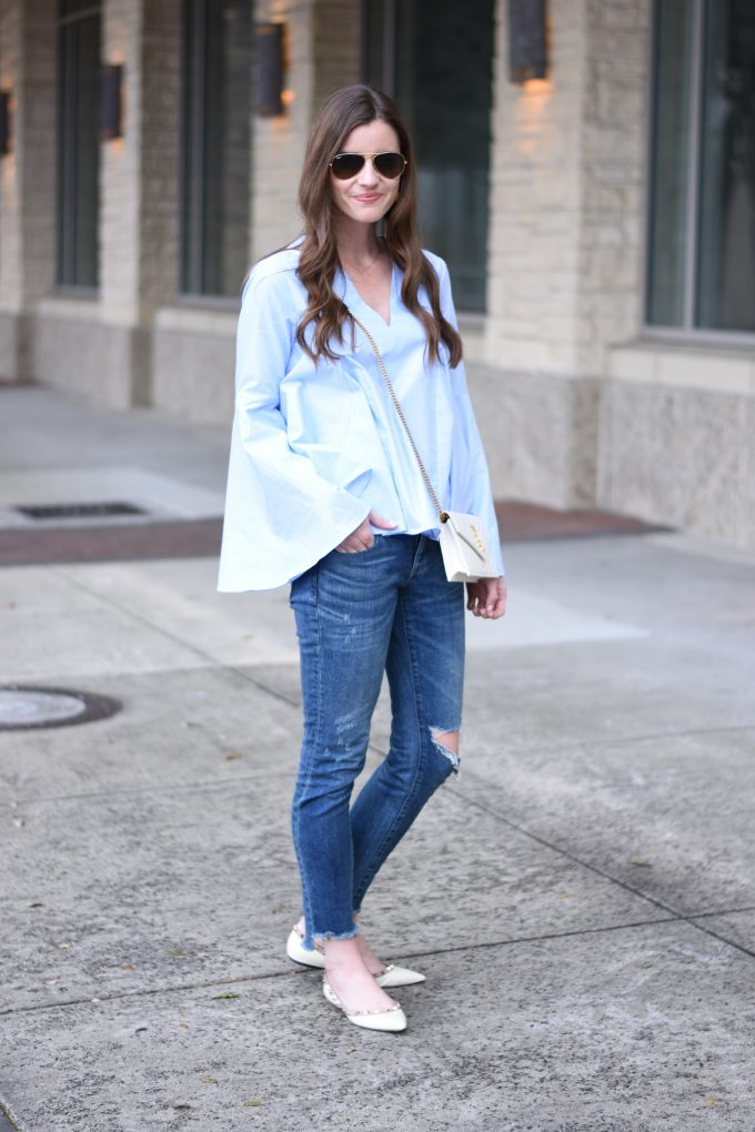 light blue bell sleeve top with distressed jeans