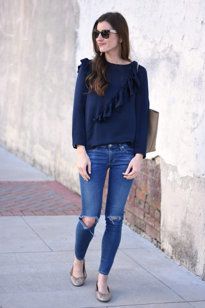 navy blue top with ruffle on the front