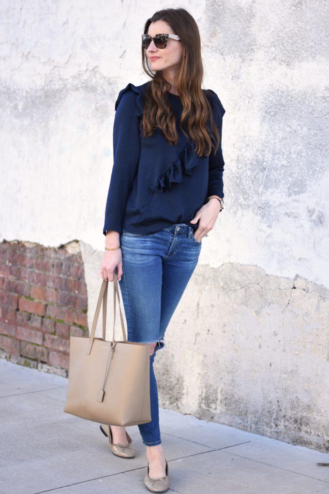 navy blue top, beige tote bag