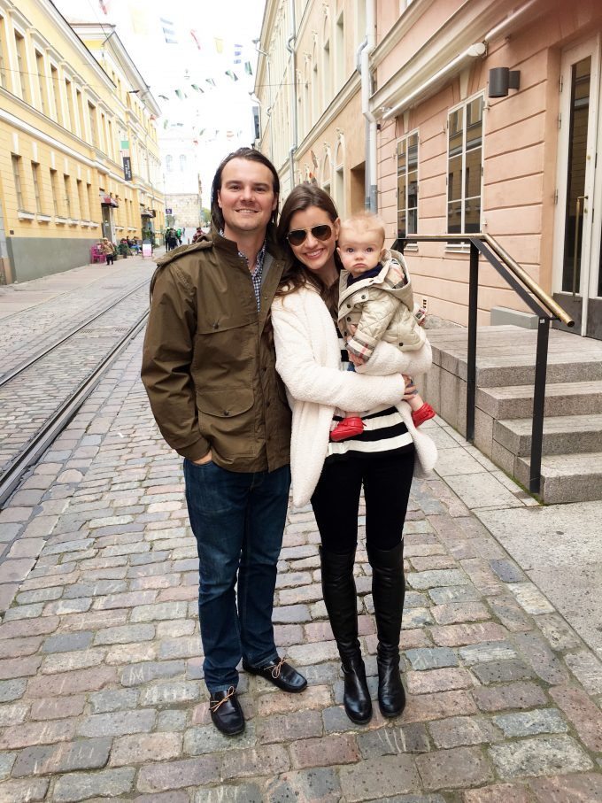 mom, dad and baby on cobblestone street