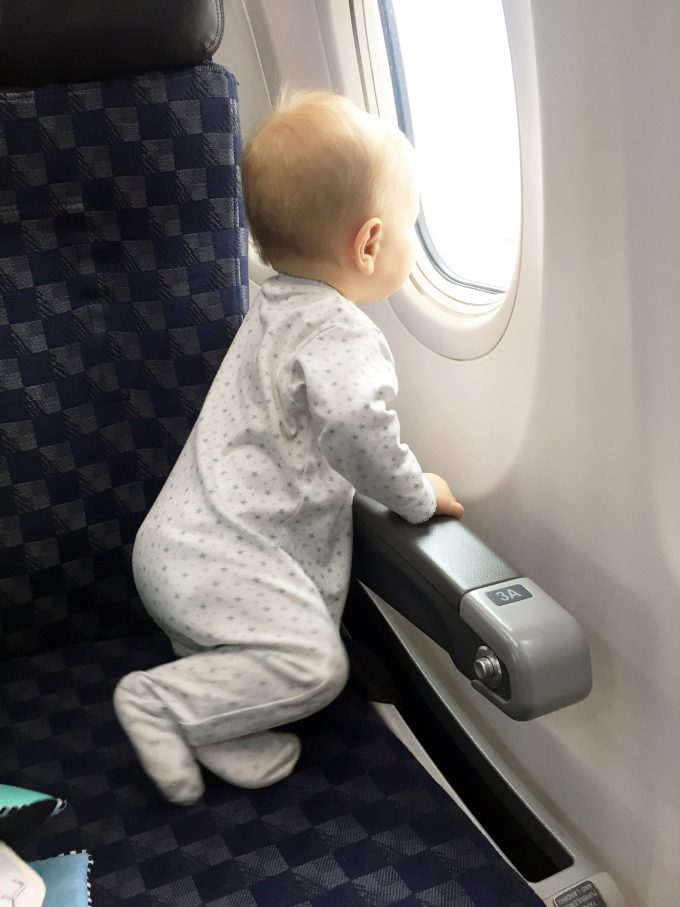 baby looking out airplane windw