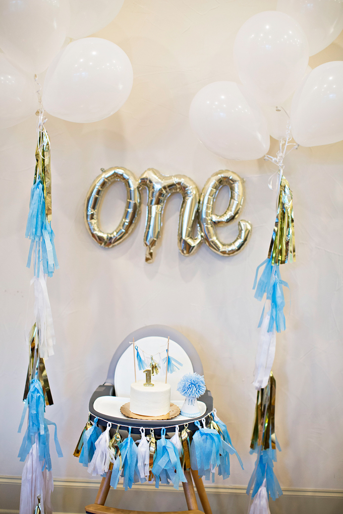 high chair and decor for a one year old's birthday party