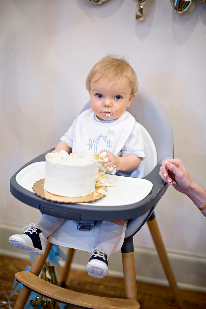 one year old baby eating birthday cake