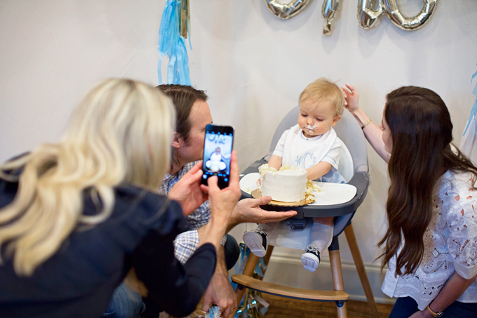 taking a photo of baby at his forst birthday