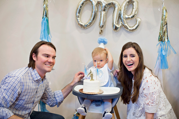 mom and dad with baby at first birthday party