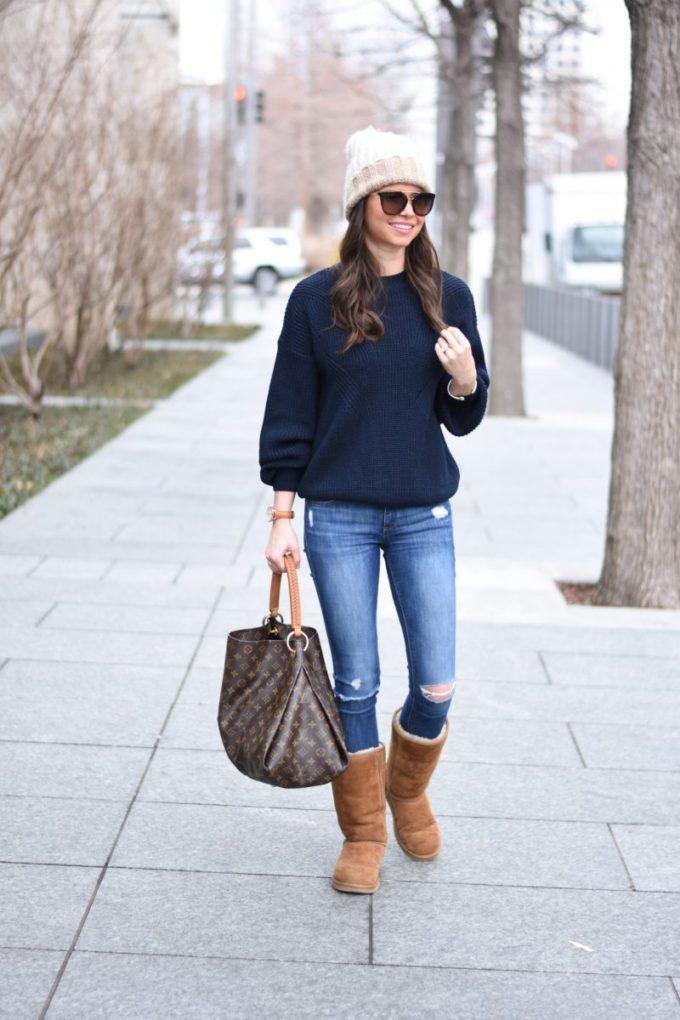 pom pom beanie, navy blue sweater