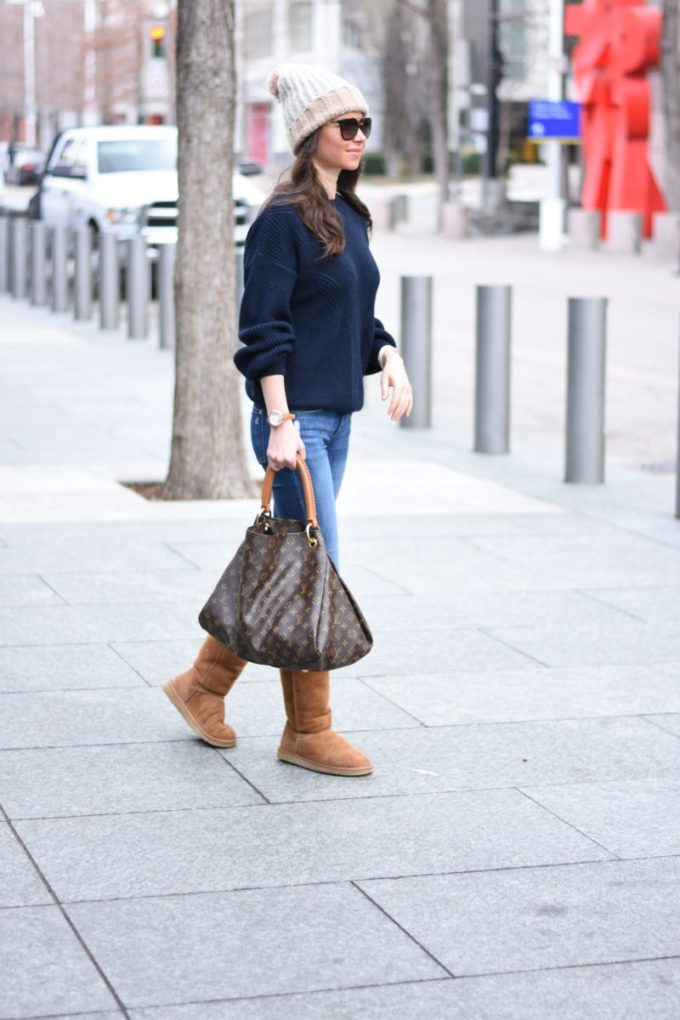 pom pom beanie with a navy sweater and UGG boots