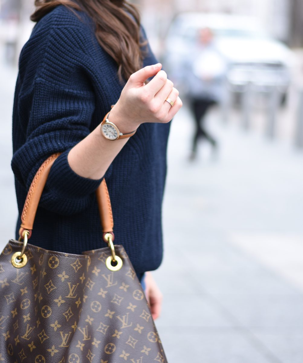 a hobo bag and navy blue sweater