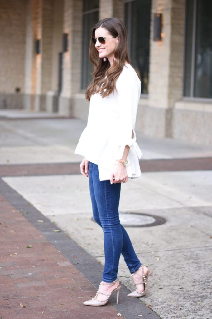 white top with ruffle hem and tie sleeves