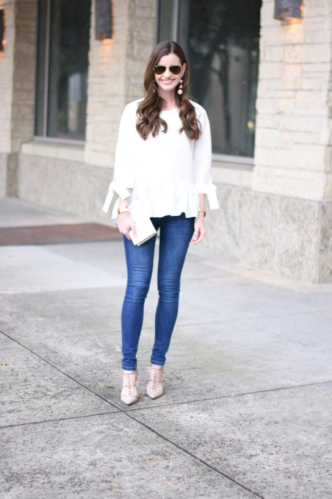 white top with rufle hem and tie sleeves with jeans and rockstuds