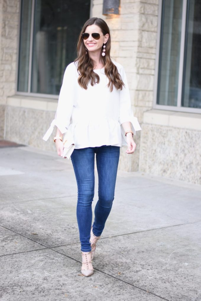 white ruffle pleat hem top with jeans