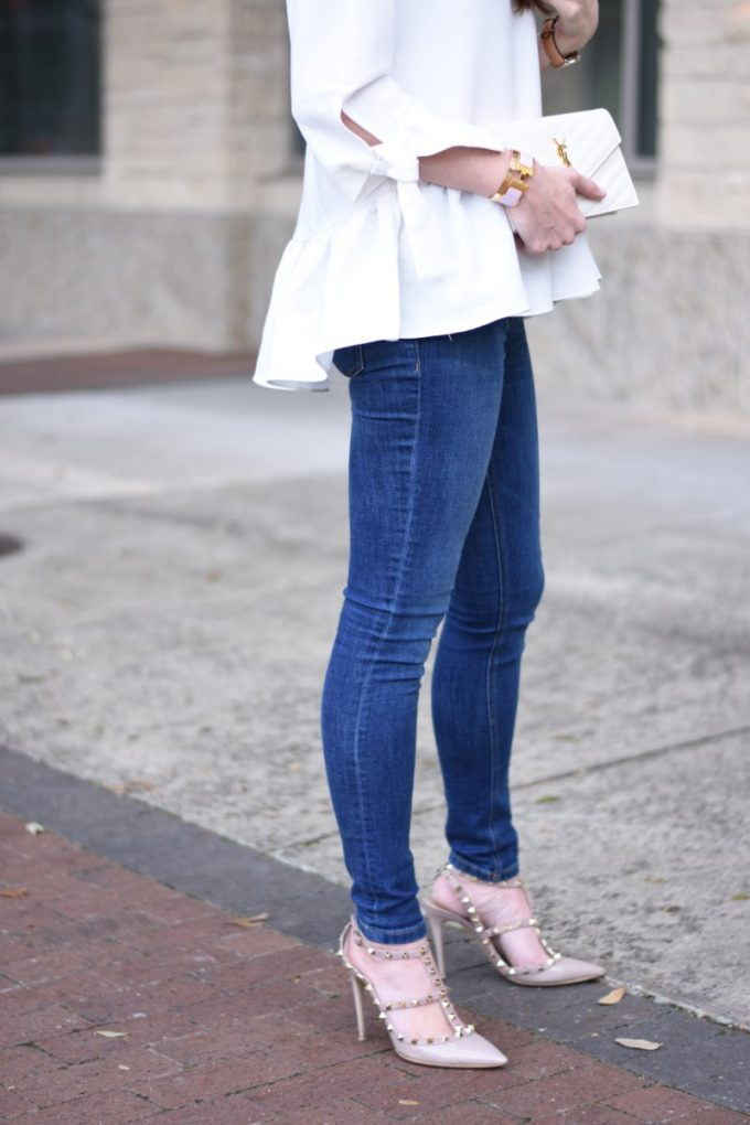white ruffle hem top with jenas and valentino rockstuds