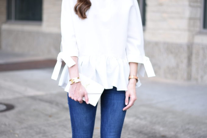 white top with ruffle pleat hem and tie sleves
