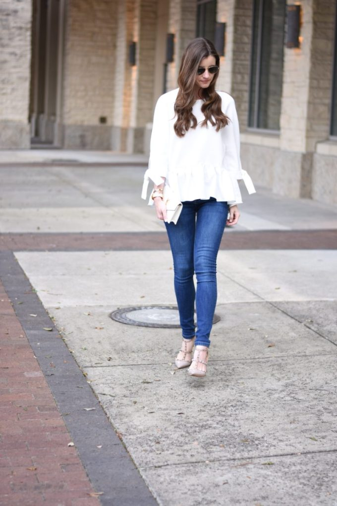 white ruffle hem top with tie sleeves and jeasn