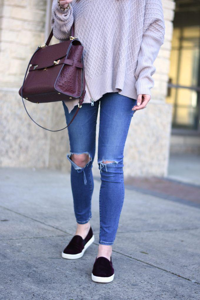 distressed jeans, burgundy handbag, burgundy velvet sneakers