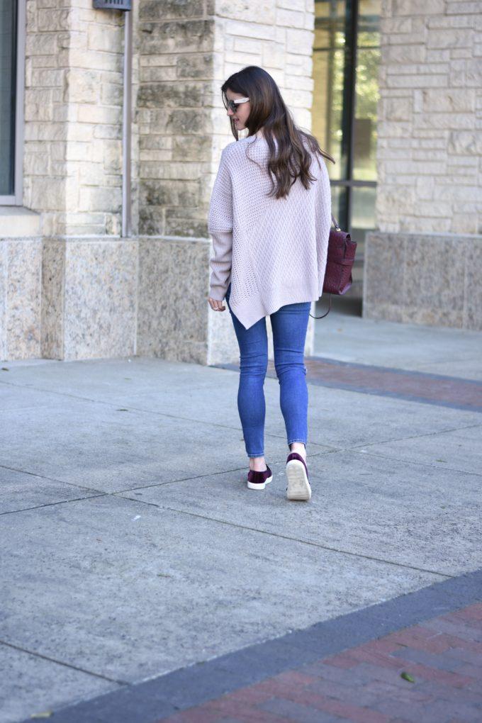 light purple oversized sweater worn with jeans