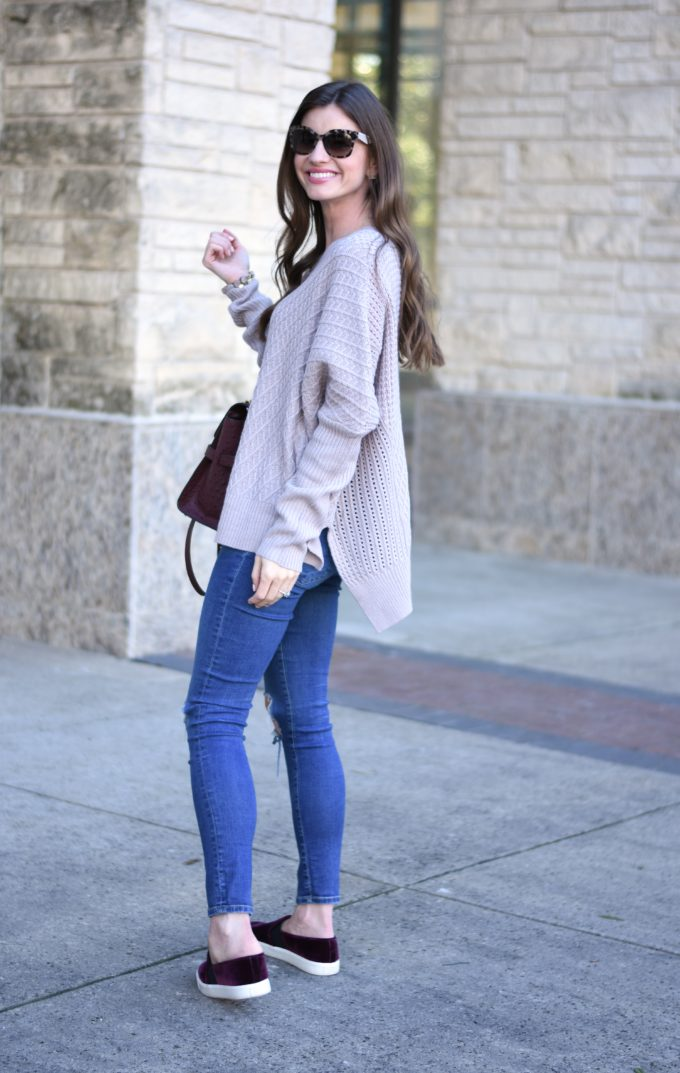 oversized sweater with jeans and burgaundy velvet sneakers