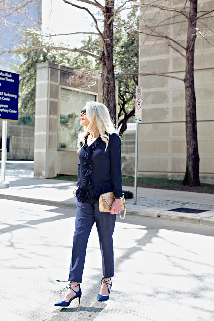 vay blue top and navy blue pants and heels
