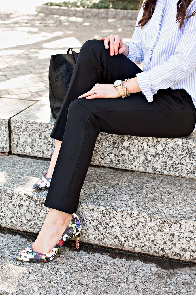 black pants and floral pumps