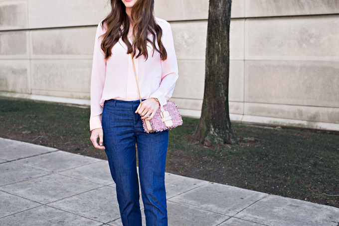 pale pink blouse with tweed cross body bag and denim pants