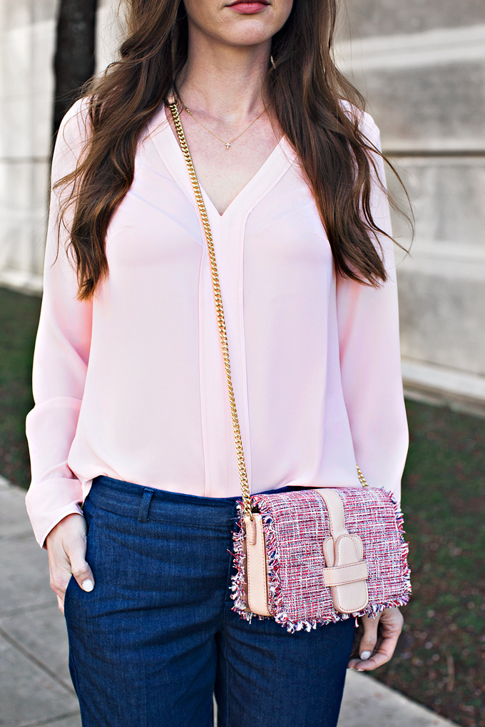 pale pink blouse with tweed cross body bag