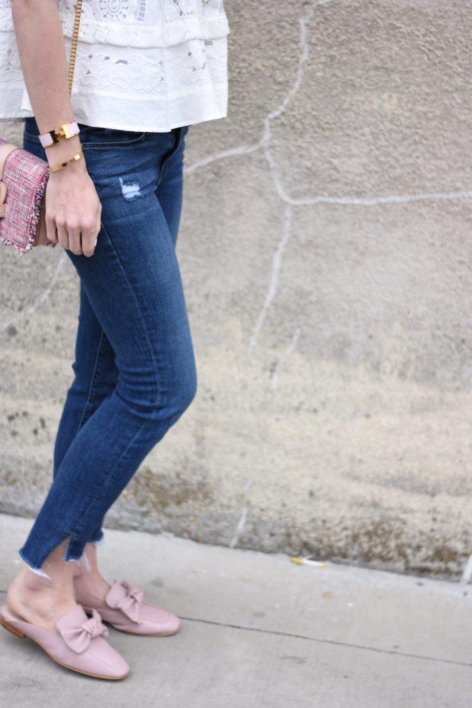 split hem frayed jeans, pink tweed handbag, blush pink loafers with bow