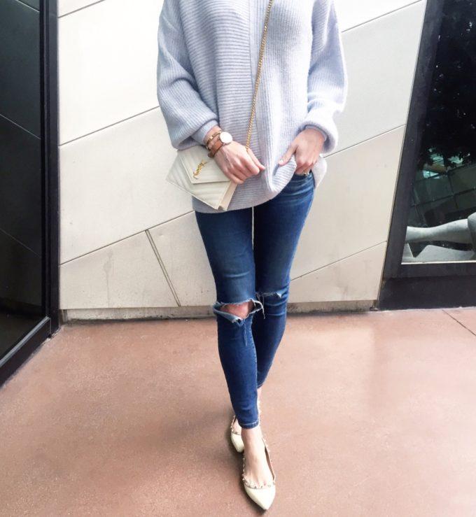 blue sweater, distressed jeans, rockstud flats