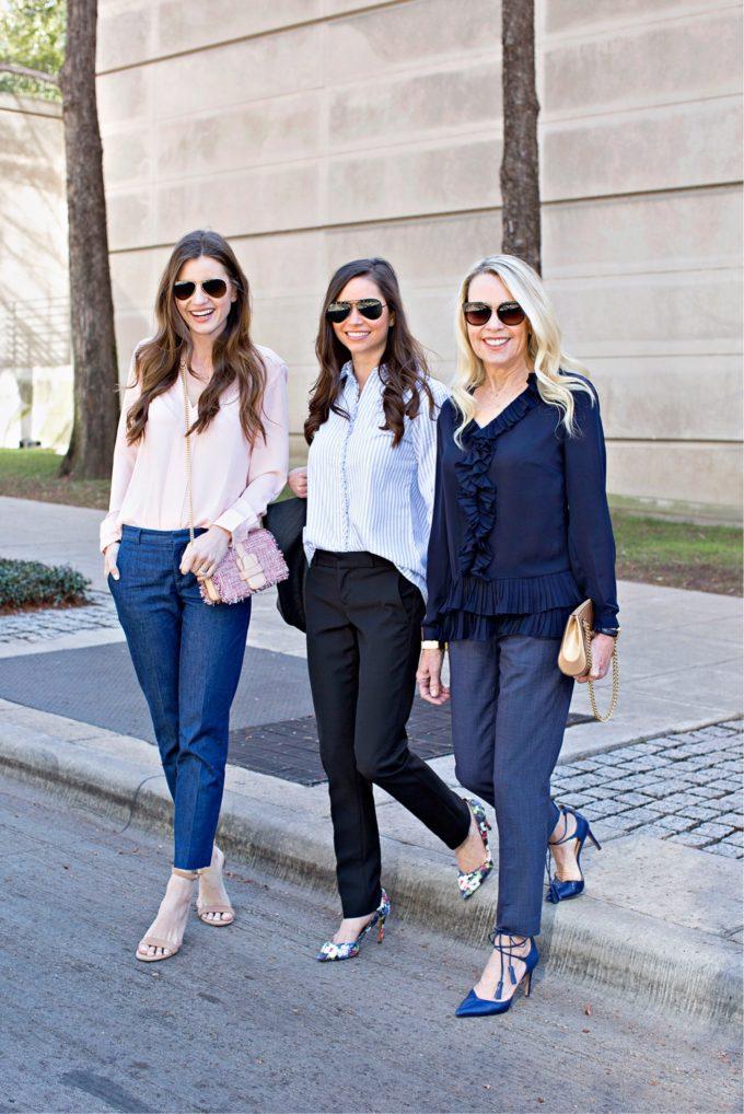 three women crossing the street in dress pants