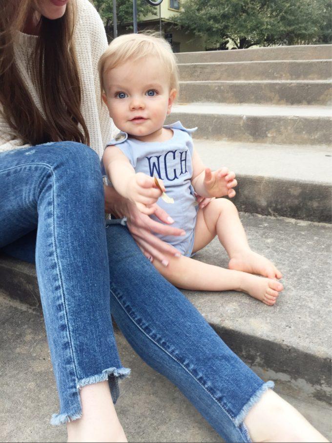 baby boy in light blue onesie with monogram