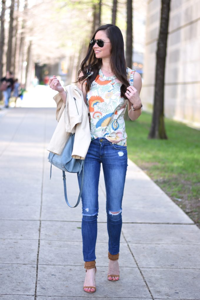 paisley top, cream leather jacket, blue suede handbag