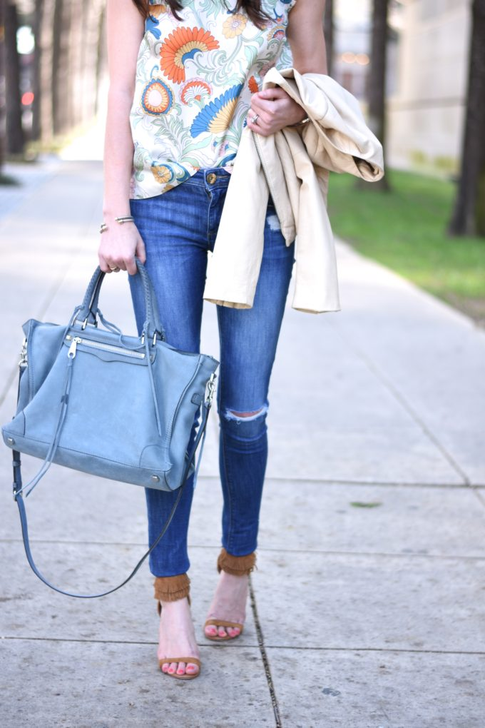 distressed jeans, blue handbag