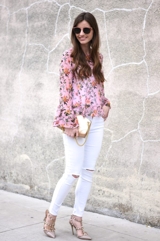 floral top, white distressed jeans, gold clutch, rockstud pumps