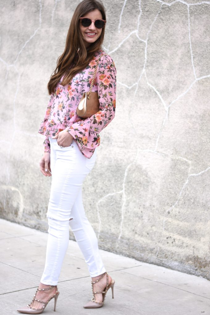 floral top, white jeans, rockstud pumps