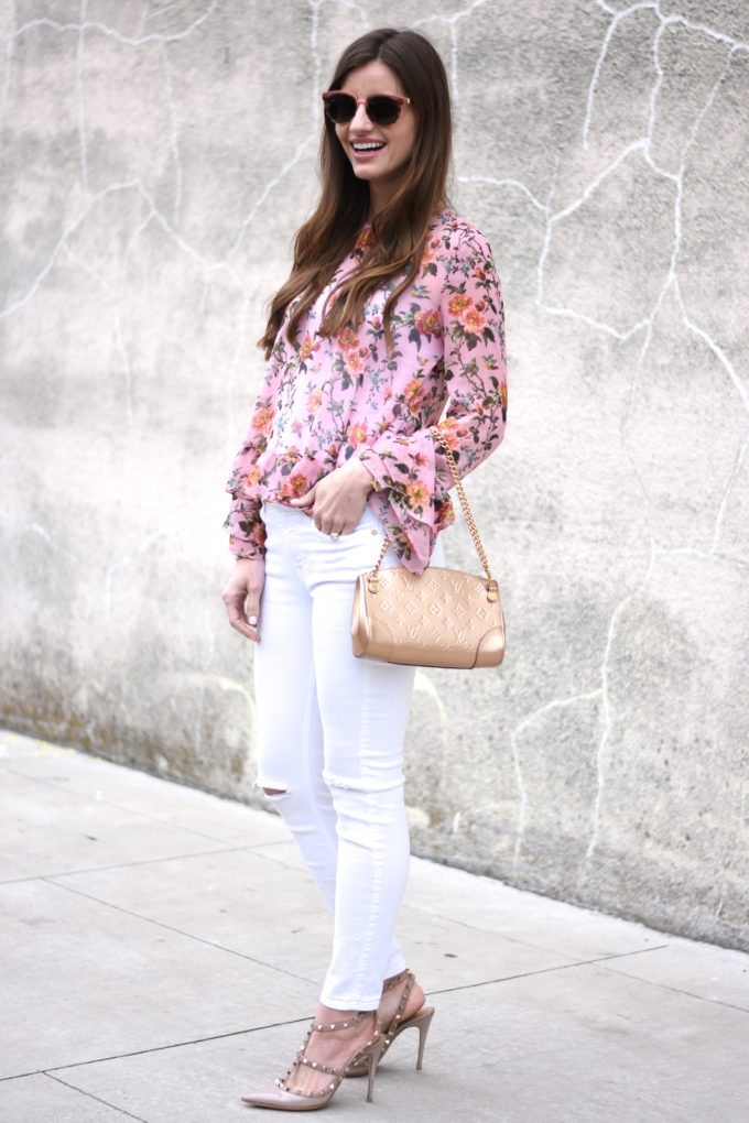 floral top, white distressed jeans, gold clutch