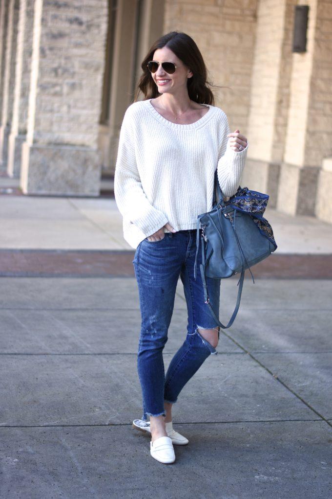 white oversized sweater, blue suede handbag