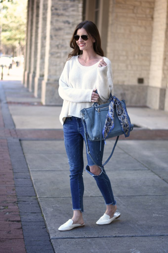 white sweater, distressed jeans, ble handbag