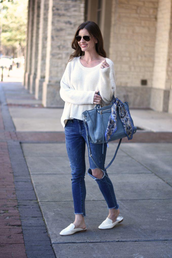 white sweater, distressed jeans, ble handbag