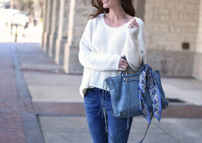 blue suede handbag, white sweater
