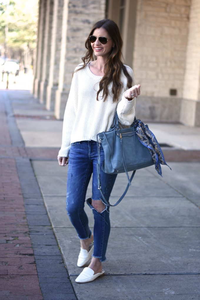 blue suede handbag, distressed jeans, white sweater