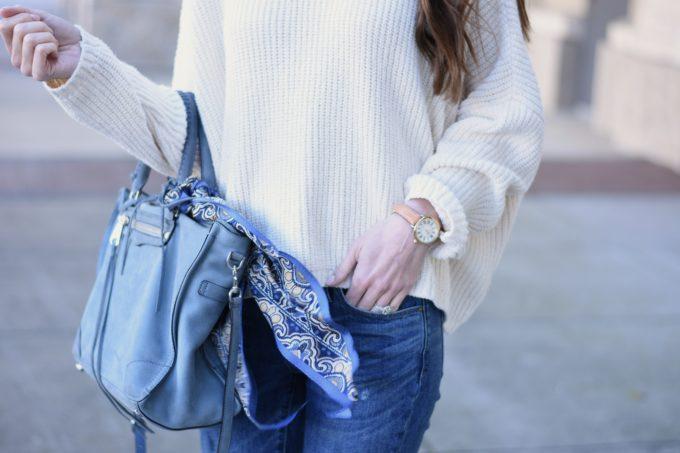 blue handbag with scarf tied on