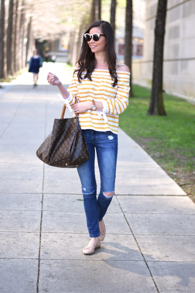 yellow striped off the shoulder top, distressed jeans, hobo bag