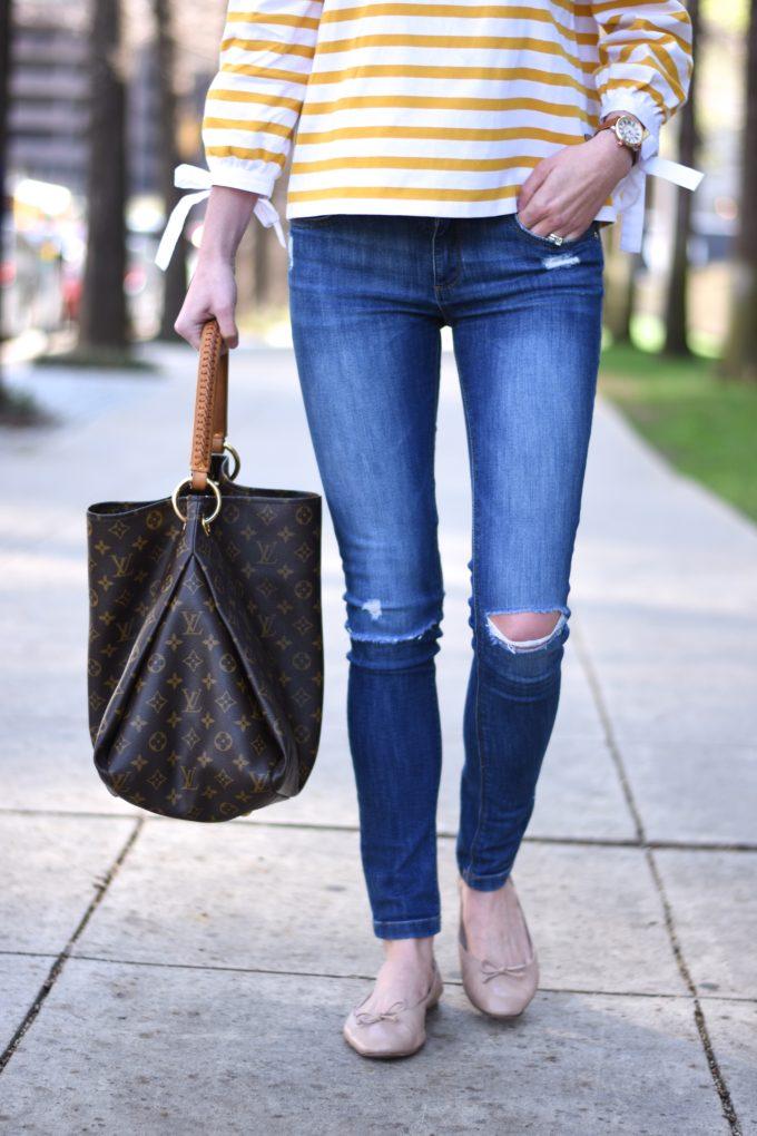 distressed jeans, hobo bag