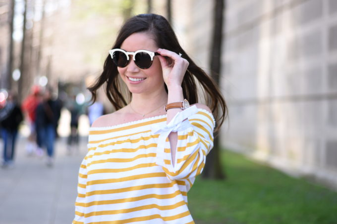 white sunglasses, yellow off the shoulder top