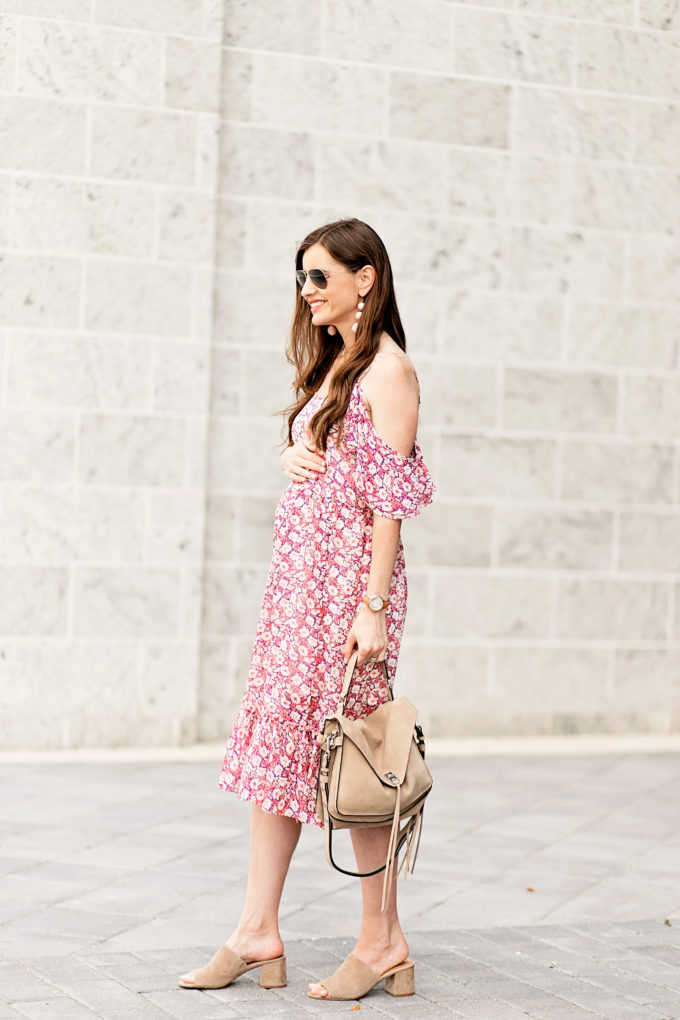 pregnant woman wearing floral midi dress