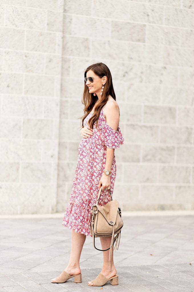 pregnant woman wearing floral midi dress