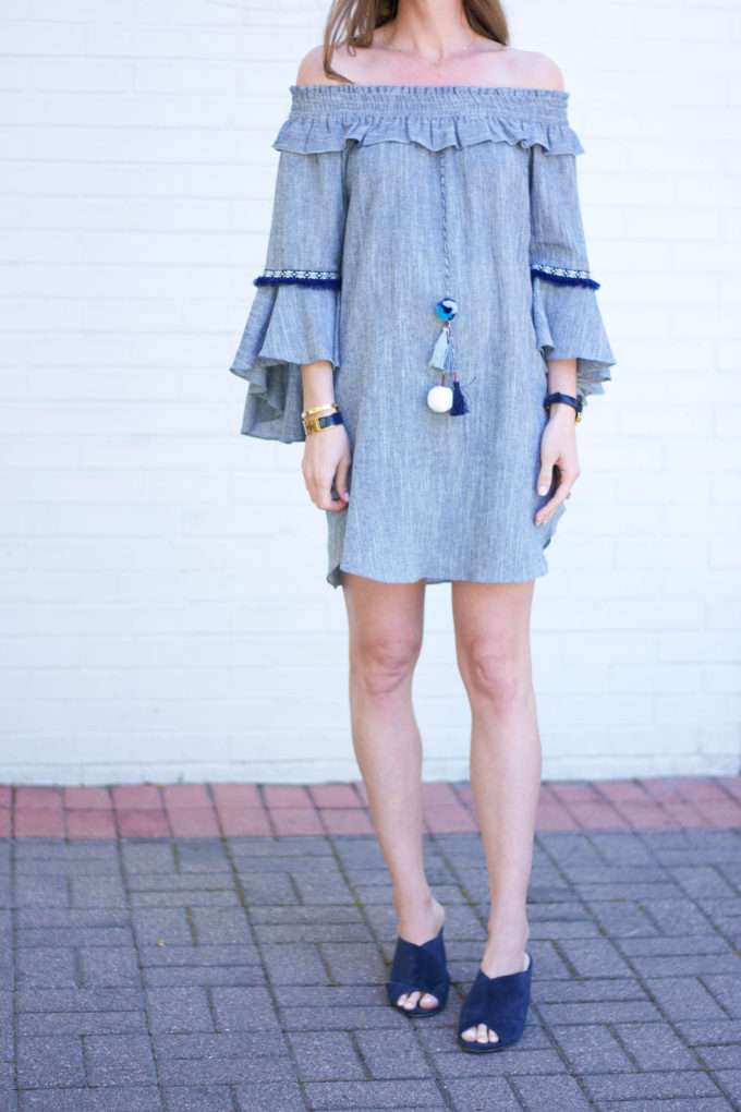 blue dress with pom pom detail