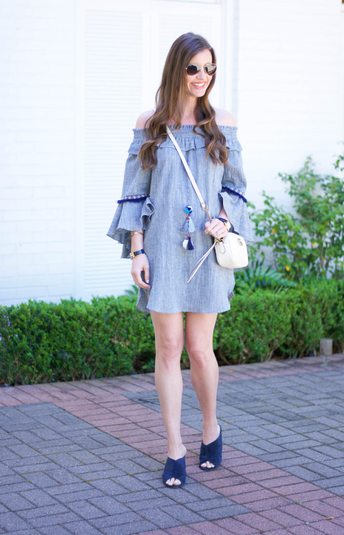 blue dress with bell sleeves, white cross body bag, blue slides