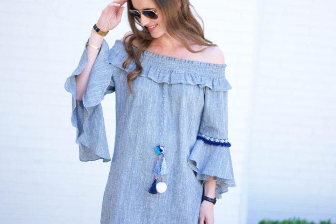 blue off the shoulder dress with pom pom detail