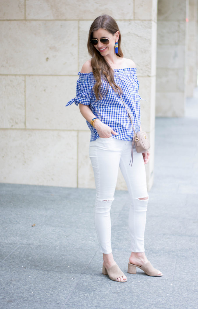 blue and white of the shoulder top, white jeans