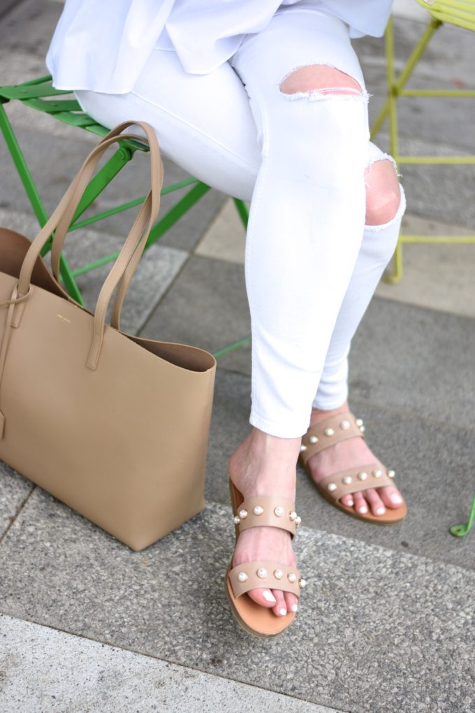 embellished slides, distressed white jeans jeans, tan tote bag